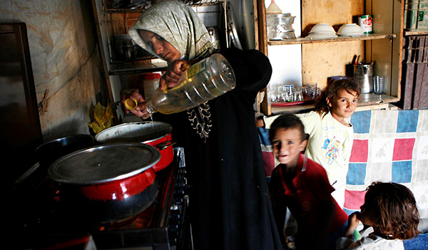 A Bedouin woman cooking for her family. Photo by Nati Shohat/FLASH90.