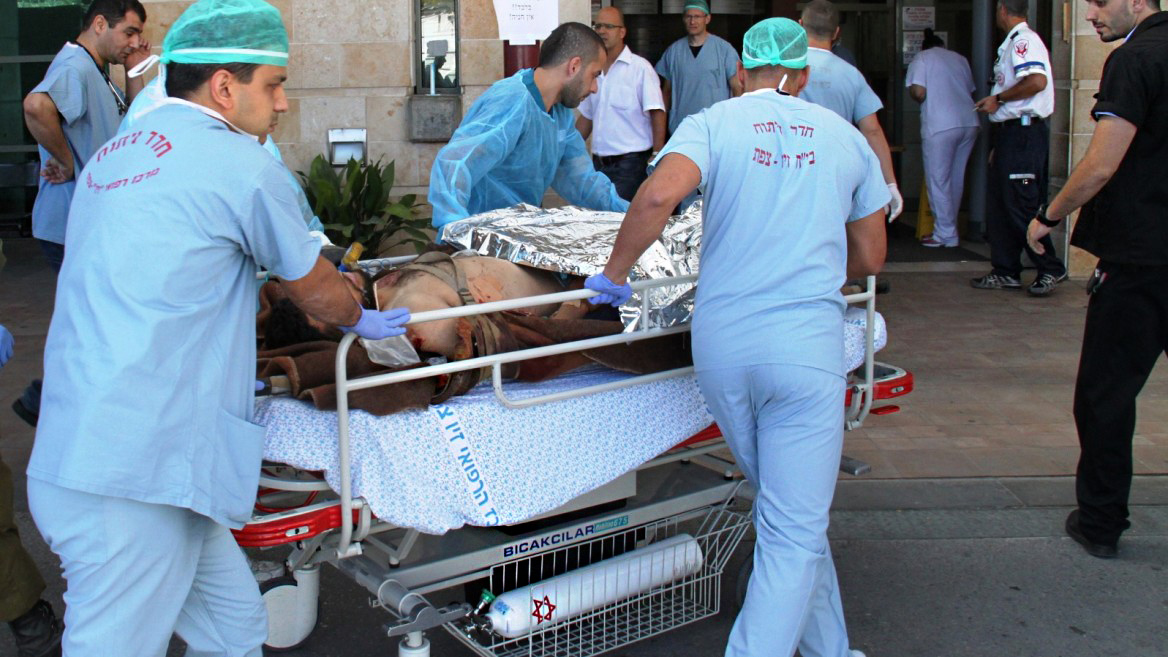 An injured civilian from the civil war in Syria being transferred to Ziv Medical Center in Israel. PHOTO: Simon Haddad